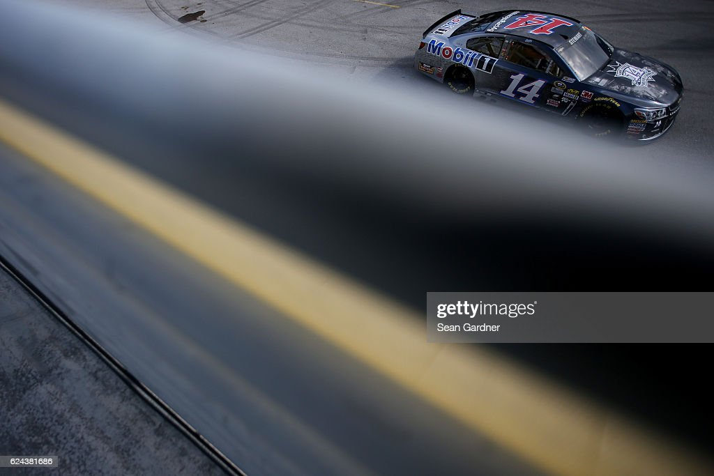 Tony Stewart, driver of the #14 Always a Racer/Mobil 1 Chevrolet, drives through the garage area during practice for the NASCAR Sprint Cup Series Ford EcoBoost 400 at Homestead-Miami Speedway on November 19, 2016 in Homestead, Florida.