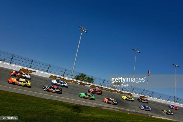 Tony Stewart , driver of the Armor All Toyota, and Clint Bowyer, driver of the BB&T Chevrolet, lead the field during the NASCAR Nationwide Series...