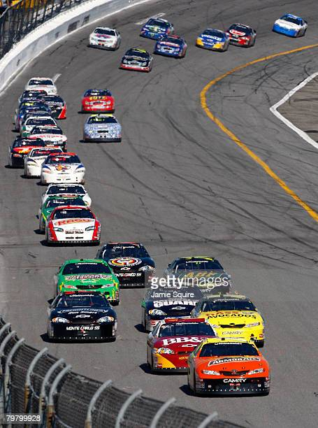 Tony Stewart, driver of the Armor All Toyota, leads the field during the NASCAR Nationwide Series Camping World 300 at Daytona International Speedway...