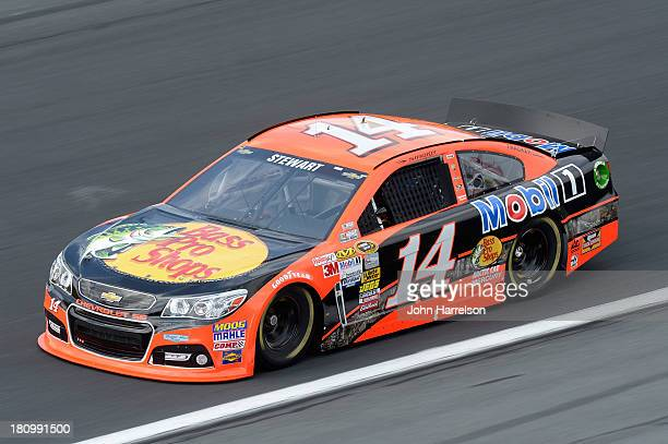 Tony Stewart driver of the Bass Pro Shops / Mobil 1 Chevrolet during practice for the NASCAR Sprint Cup Series CocaCola 600 at Charlotte Motor...