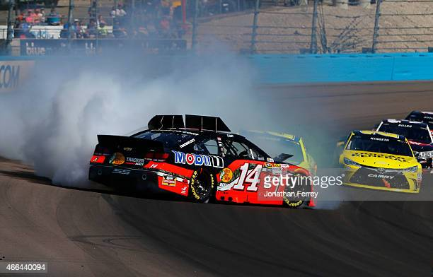Tony Stewart driver of the Bass Pro Shops / Mobil 1 Chevrolet is involved in an incident on the track during the NASCAR Sprint Cup Series...