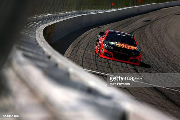 Tony Stewart driver of the Bass Pro Shops / Mobil 1 Chevrolet practices for the NASCAR Sprint Cup Series OralB USA 500 at Atlanta Motor Speedway on...