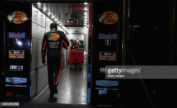 Tony Stewart driver of the Bass Pro Shops / Mobil 1 Chevrolet walks into his hauler after an on track incident during the NASCAR Sprint Cup Series...