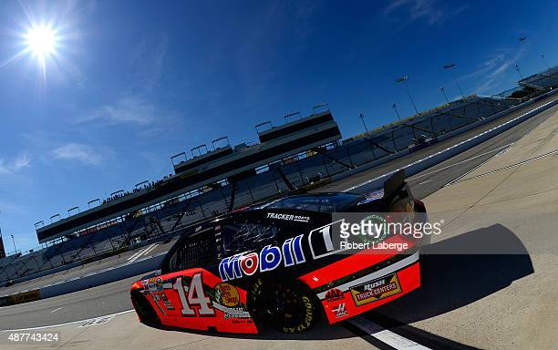 Tony Stewart driver of the Bass Pro Shops/Mobil 1 Chevrolet drives through the garage area during practice for the NASCAR Sprint Cup Series Federated...