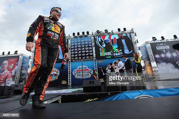 Tony Stewart driver of the Bass Pro Shops/Mobil 1 Chevrolet is introduced during prerace ceremonies for the NASCAR Sprint Cup Series Ford EcoBoost...