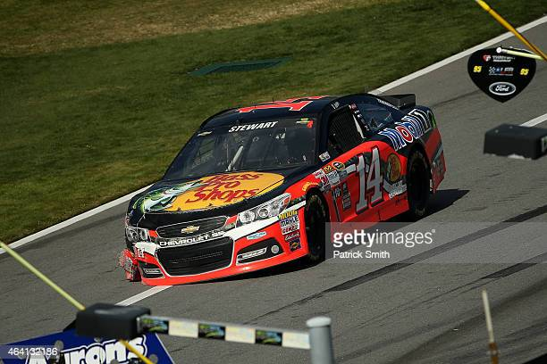 Tony Stewart driver of the Bass Pro Shops/Mobil 1 Chevrolet pits for repairs after being involved in an ontrack incident during the NASCAR Sprint Cup...