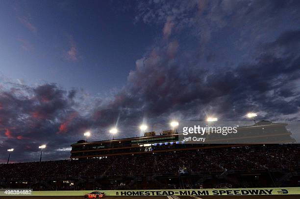 Tony Stewart driver of the Bass Pro Shops/Mobil 1 Chevrolet races during the NASCAR Sprint Cup Series Ford EcoBoost 400 at HomesteadMiami Speedway on...