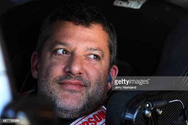 Tony Stewart driver of the Bass Pro Shops/Mobil 1 Chevrolet sits in his car during practice for the NASCAR Sprint Cup Series Federated Auto Parts 400...