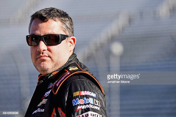 Tony Stewart driver of the Bass Pro Shops/Mobil 1 Chevrolet stands on the grid during qualifying for the NASCAR Sprint Cup Series Goody's Headache...