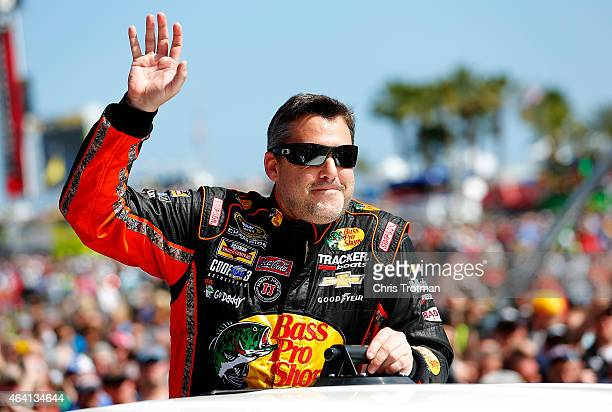 Tony Stewart driver of the Bass Pro Shops/Mobil 1 Chevrolet takes part in prerace ceremonies for the NASCAR Sprint Cup Series 57th Annual Daytona 500...