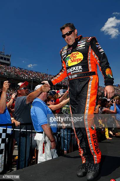 Tony Stewart driver of the Bass Pro Shops/Tracker Boats Chevrolet is introduced prior to the NASCAR Sprint Cup Series GEICO 500 at Talladega...
