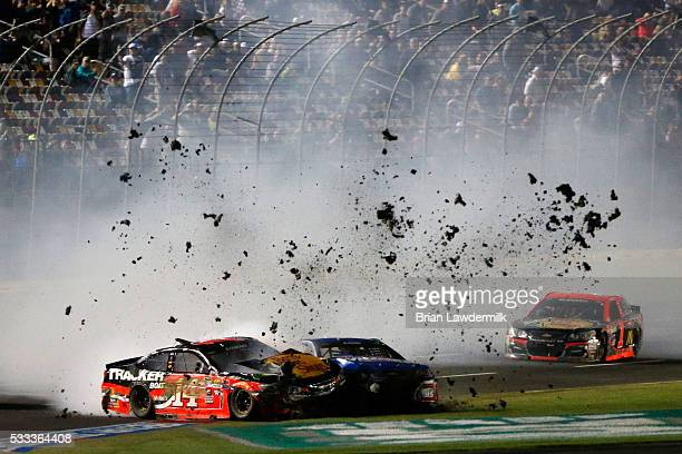 Tony Stewart driver of the Bass Pro Shops/Tracker Chevrolet and Kasey Kahne driver of the Drive Home A Winner Chevrolet have an on track incident...