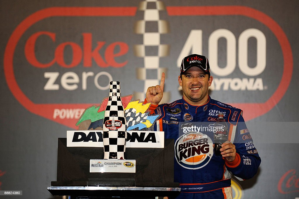 Tony Stewart, driver of the #14 Burger King Chevrolet, celebrates in victory lane after winning the NASCAR Sprint Cup Series 51st Annual Coke Zero 400 at Daytona International Speedway on July 4, 2009 in Daytona Beach, Florida.
