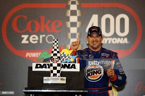 Tony Stewart driver of the Burger King Chevrolet celebrates in victory lane after winning the NASCAR Sprint Cup Series 51st Annual Coke Zero 400 at...
