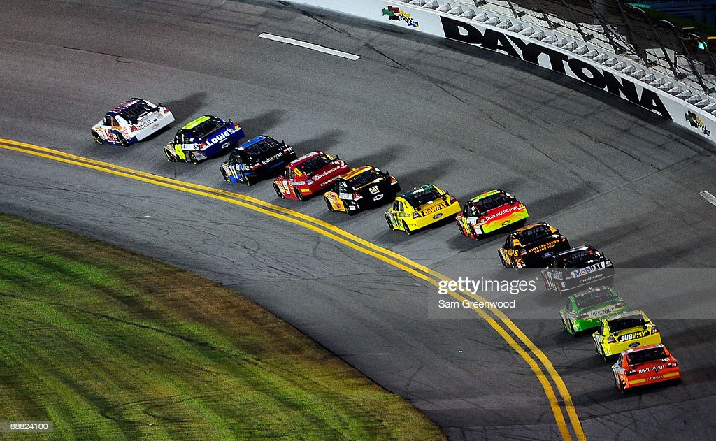 Tony Stewart, driver of the #14 Burger King Chevrolet, leads the field during the NASCAR Sprint Cup Series 51st Annual Coke Zero 400 at Daytona International Speedway on July 4, 2009 in Daytona Beach, Florida.