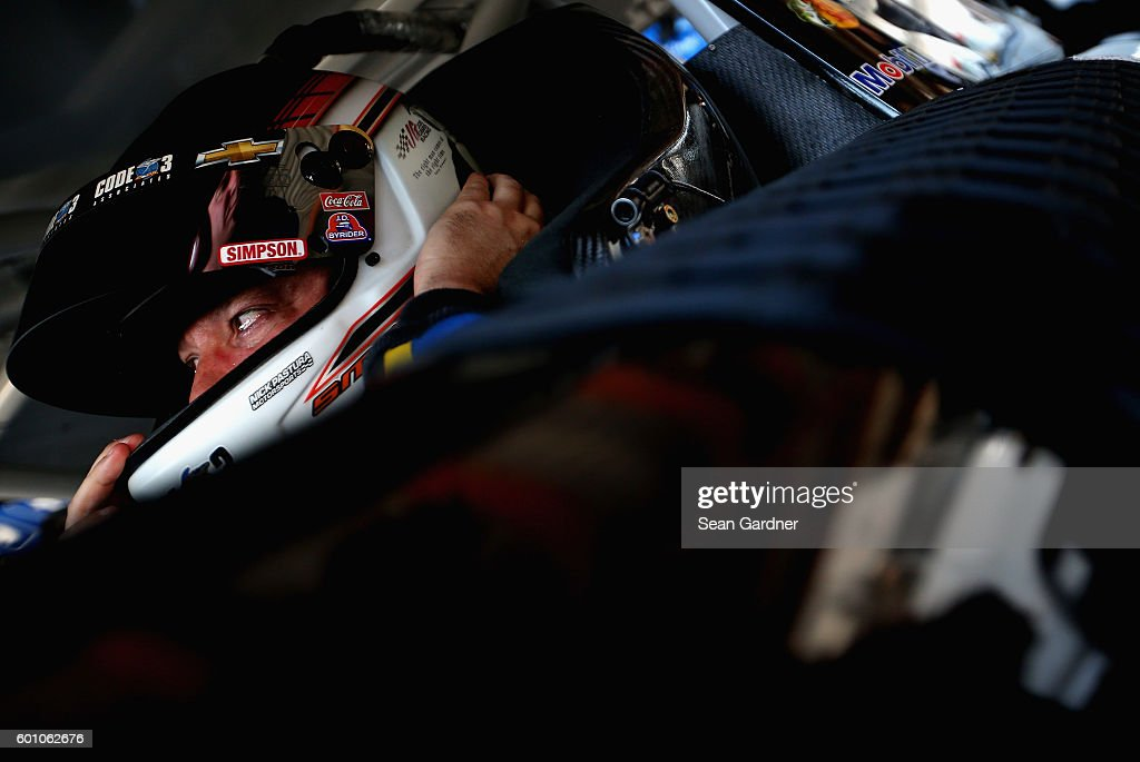 Tony Stewart, driver of the #14 Code 3 Associates/Mobil 1 Chevrolet, adjusts his helmet during practice for the NASCAR Sprint Cup Series Federated Auto Parts 400 at Richmond International Raceway on September 9, 2016 in Richmond, Virginia.