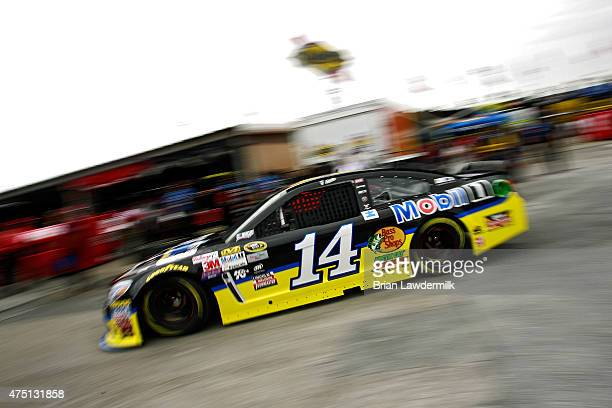 Tony Stewart driver of the Code 3 Associates/Mobil 1 Chevrolet drives through the garage area during practice for the NASCAR Sprint Cup Series FedEx...