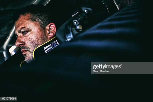 Tony Stewart driver of the Code 3 Associates/Mobil 1 Chevrolet sits in his car during practice for the NASCAR Sprint Cup Series Federated Auto Parts...