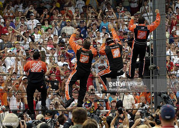 Tony Stewart, driver of the Home Depot Chevrolet, and his crew celebrate winning the NASCAR Nextel Cup Series Allstate 400 on August 7, 2005 at the...