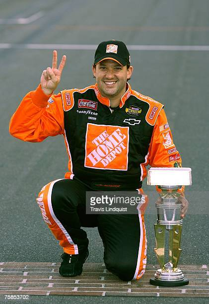 Tony Stewart driver of the Home Depot Chevrolet celebrates after winning the NASCAR Nextel Cup Series 14th Allstate 400 at the Brickyard at...