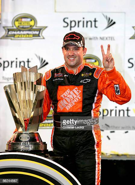 Tony Stewart driver of the Home Depot Chevrolet celebrates winning the NASCAR Nextel Cup Championship after the Ford 400 on November 20 2005 at...