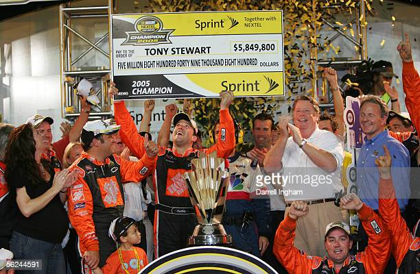 Tony Stewart driver of the Home Depot Chevrolet celebrates winning the championship with his crew after the NASCAR Nextel Cup Ford 400 on November 20...