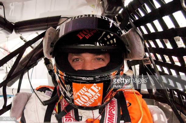 Tony Stewart driver of the Home Depot Chevrolet Monte Carlo looks on from the driver seat during practice for The Winston on May 16 2003 at Lowes...