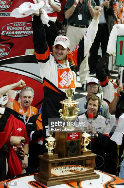 Tony Stewart driver of the Home Depot Pontiac Grand Prix celebrates after winning the NASCAR Winston Cup Championship at the NASCAR Winston Cup...