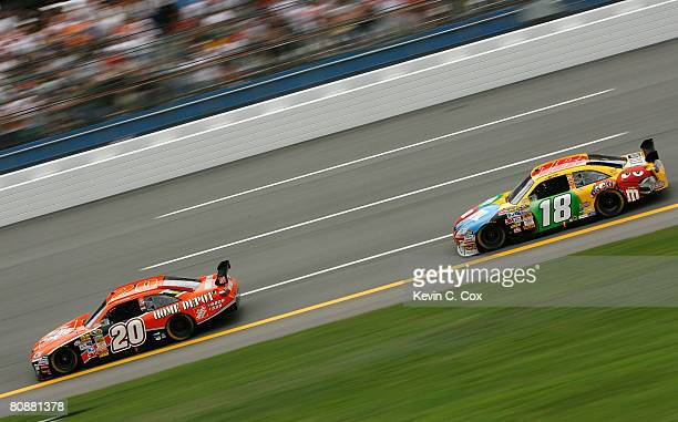 Tony Stewart driver of the Home Depot Toyota leads Kyle Busch driver of the MM's Toyota during the NASCAR Sprint Cup Series Aaron's 499 at Talladega...