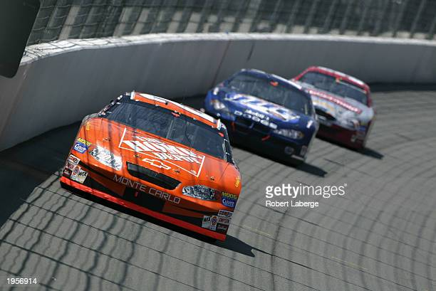 Tony Stewart driver of the Joe Gibbs Racing Chevrolet Monte Carlo leads a pack of cars during the NASCAR Winston Cup AUTO CLUB 500 on April 27 2003...