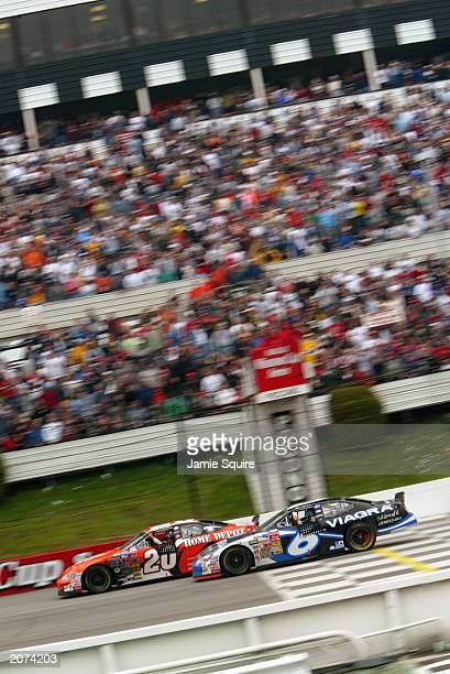 Tony Stewart driver of the Joe Gibbs Racing Chevrolet Monte Carlo celebrates as he finishes in first place beating Mark Martin driver of the Viagra...