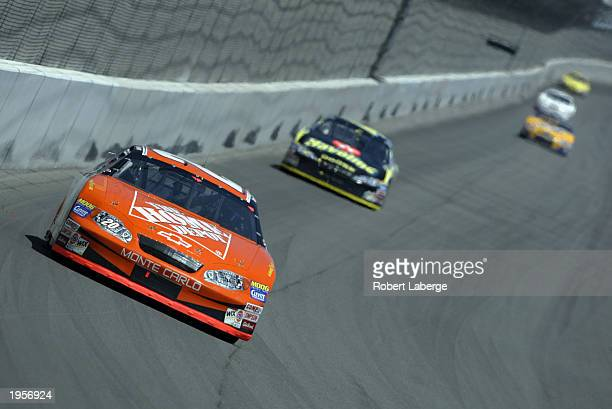 Tony Stewart driver of the Joe Gibbs Racing Chevrolet Monte Carlo leads the race during the NASCAR Winston Cup AUTO CLUB 500 on April 27 2003 at the...