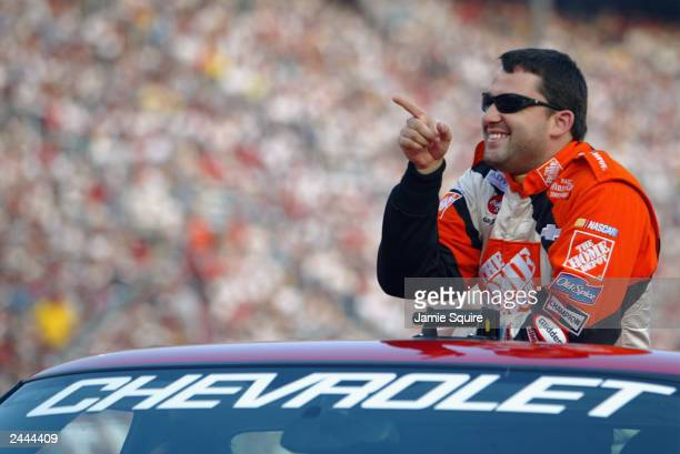 Tony Stewart driver of the Joe Gibbs Racing Chevrolet Monte Carlo points to the crowd during driver introductions prior to the NASCAR Sharpie 500 on...