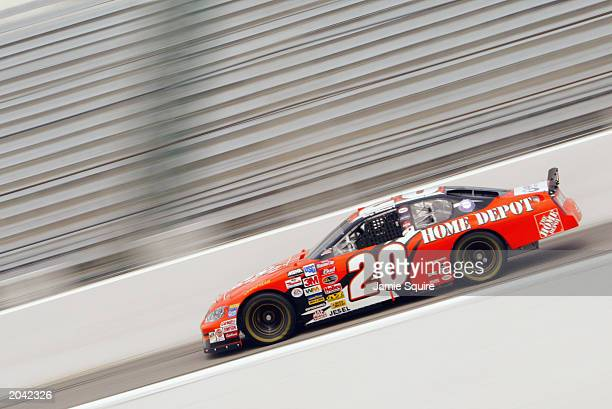 Tony Stewart driver of the Joe Gibbs Racing Dodge Intrepid in action during practice for the NASCAR Carolina Dodge Dealers 400 on March 14 2003 at...