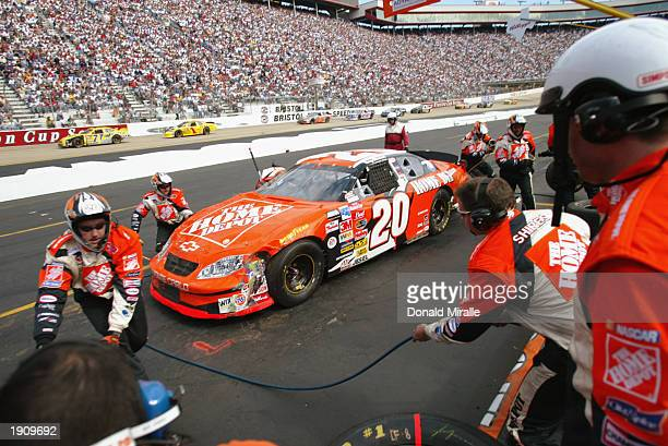 Tony Stewart driver of the Joe Gibbs Racing Home Depot Chevrolet makes a pit stop during the NASCAR Winston Cup Food City 500 at Bristol Motor...