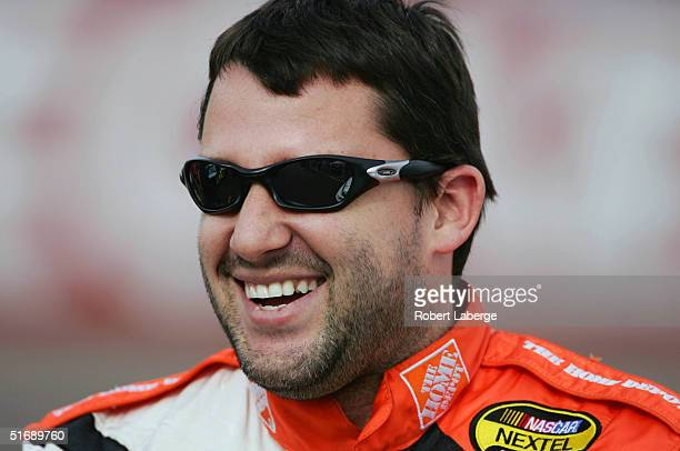 Tony Stewart driver of the Joe Gibbs Racing Home Depot Chevrolet looks on before his qualifying run for the NASCAR Nextel Cup Series Checker Auto...