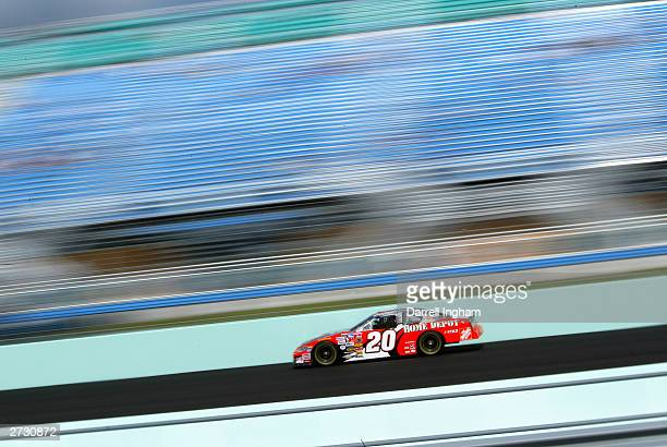 Tony Stewart driver of the Joe Gibbs Racing Home Depot Chevrolet during qualifying for the NASCAR Winston Cup Ford 400 on November15 2003 at...