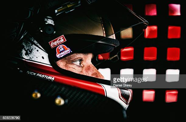 Tony Stewart driver of the Mobil 1 Advanced Fuel Economy Chevrolet sits in his car during practice for the NASCAR Sprint Cup Series TOYOTA OWNERS 400...