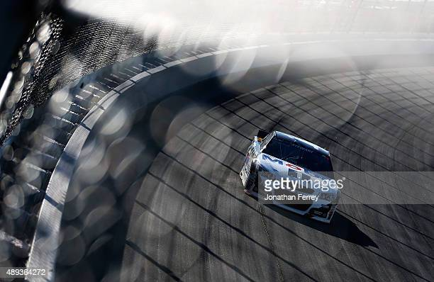 Tony Stewart driver of the Mobil 1 / Bass Pro Shops Chevrolet races during the NASCAR Sprint Cup Series myAFibRiskcom 400 at Chicagoland Speedway on...