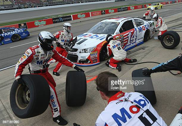 Tony Stewart driver of the Mobil 1 Chevrolet pits during the NASCAR Sprint Cup Series Pure Michigan 400 at Michigan International Speedway on August...