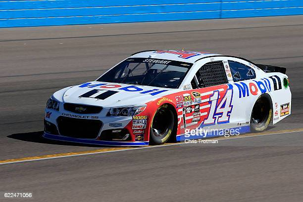 Tony Stewart driver of the Mobil 1 Chevrolet practices for the NASCAR Sprint Cup Series CanAm 500 at Phoenix International Raceway on November 11...