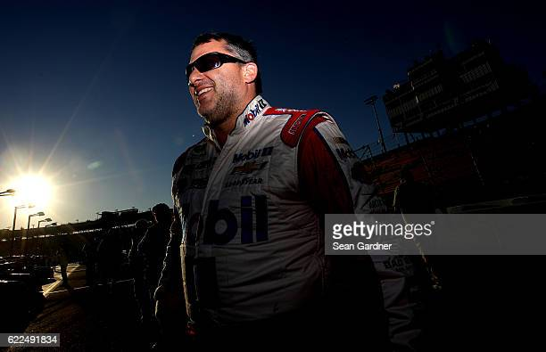 Tony Stewart driver of the Mobil 1 Chevrolet walks on the grid during qualifying for the NASCAR Sprint Cup Series CanAm 500 at Phoenix International...
