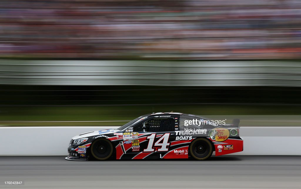 Tony Stewart, driver of the #14 Mobil 1/Bass Pro Shops Chevrolet, races during the NASCAR Sprint Cup Series Party in the Poconos 400 at Pocono Raceway on June 9, 2013 in Long Pond, Pennsylvania.