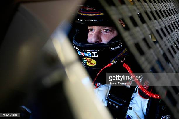 Tony Stewart driver of the Mobil 1/Bass Pro Shops Chevrolet sits in his car in the garage area during practice for the NASCAR Sprint Cup Series...