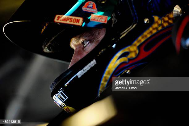 Tony Stewart driver of the Mobil 1/Bass Pro Shops Chevrolet sits in his car in the garage during practice for the NASCAR Sprint Cup Series Sprint...