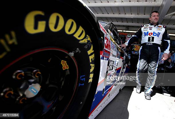 Tony Stewart driver of the Mobil 1/Bass Pro Shops Chevrolet stands in the garage area during practice for the NASCAR Sprint Cup Series Quicken Loans...