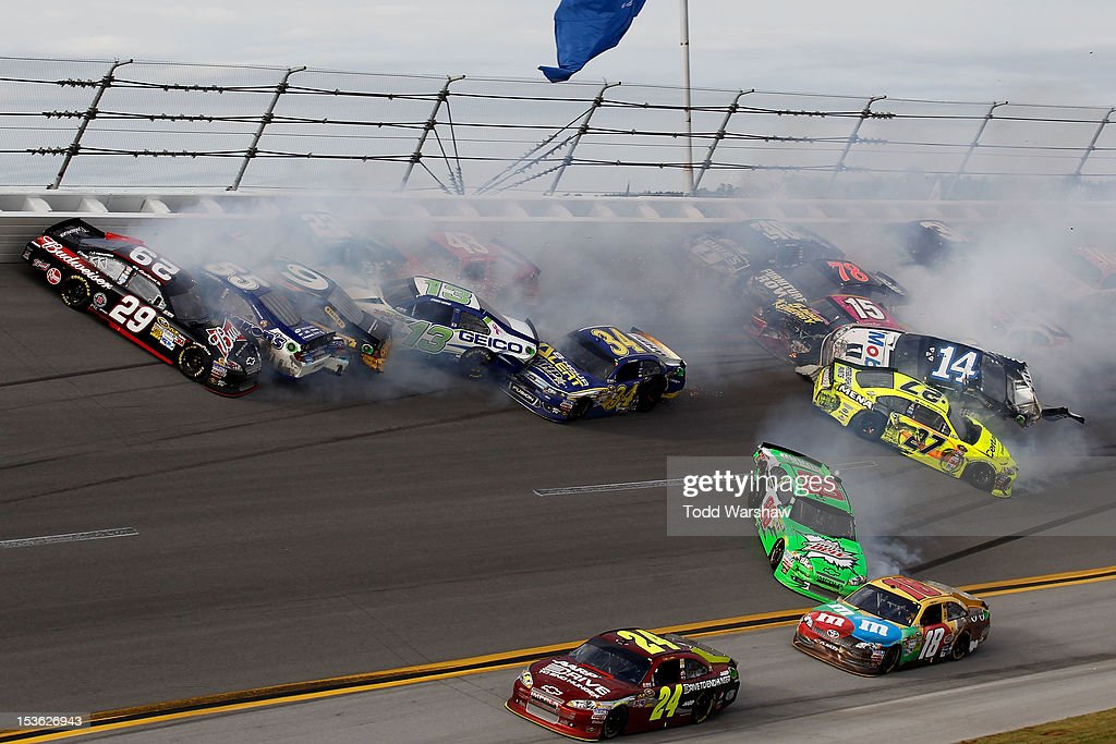 Tony Stewart, driver of the #14 Mobil 1/Office Depot Chevrolet, flips in the air after and incident with the field in the final lap of the NASCAR Sprint Cup Series Good Sam Roadside Assistance 500 at Talladega Superspeedway on October 7, 2012 in Talladega, Alabama.