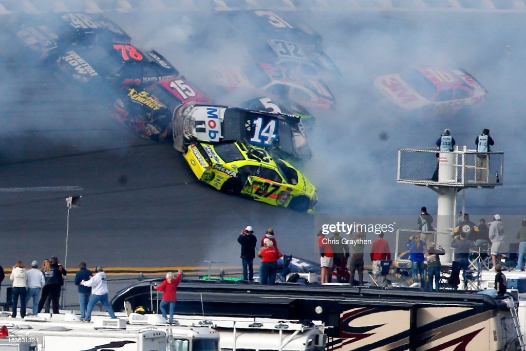 Tony Stewart, driver of the #14 Mobil 1/Office Depot Chevrolet, flips in the air after an incident with the field in the final lap of the NASCAR Sprint Cup Series Good Sam Roadside Assistance 500 at Talladega Superspeedway on October 7, 2012 in Talladega, Alabama.