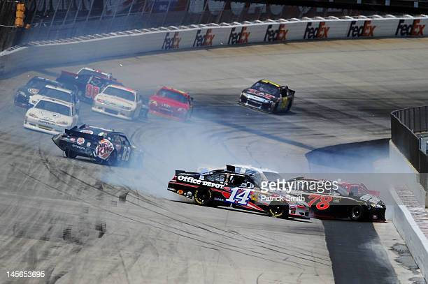 Tony Stewart driver of the Mobil 1/Office Depot Chevrolet Regan Smith driver of the Furniture Row/CSX Chevrolet and Landon Cassill driver of the...