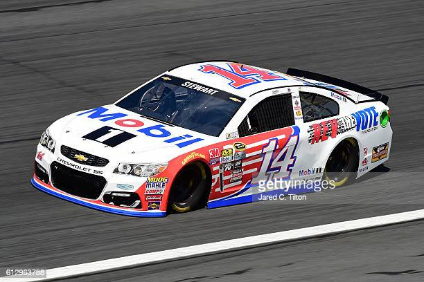 Tony Stewart driver of the Mobil 1/Rev the Vote Chevrolet practices for the NASCAR Sprint Cup Series Bank of America 500 at Charlotte Motor Speedway...